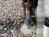 Realización de agujero en cemento para albergar portacebo
